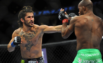 June 8, 2012; Sunrise, FL, USA; Demetrious Johnson (right) fights against Ian McCall (left) during their UFC bout at BankAtlantic Center. Mandatory Credit: Steve Mitchell-US PRESSWIRE