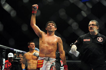 May 19, 2012; San Jose, CA, USA; Gilbert Melendez (right) fights Josh Thomson (left) during the lightweight bout of the Strikeforce World Grand Prix at HP Pavilion.  Mandatory Credit: Kyle Terada-US PRESSWIRE