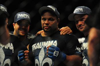May 19, 2012; San Jose, CA, USA; Daniel Cormier celebrates with the championship belt after defeating Josh Barnett (not pictured) during the heavyweight tournament final bout of the Strikeforce World Grand Prix at HP Pavilion.  Mandatory Credit: Kyle Tera