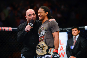 August 11, 2012; Denver, CO, USA; UFC host Joe Rogan (left) talks with Benson Henderson (right) after he defeated Frankie Edgar (not pictured) during UFC 150 at the Pepsi Center. Mandatory Credit: Ron Chenoy-US PRESSWIRE