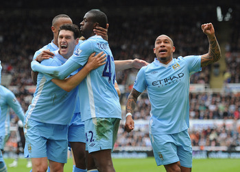 Toure, Barry and De Jong celebrate