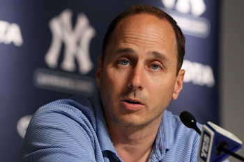 Brian Cashman's moves at just the right times have helped keep the Yankees afloat.