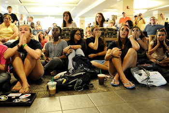 STATE COLLEGE, PA - JULY 23: Penn State students and others react to the sanctions the NCAA announced against Penn State in the HUB on the campus of Penn State on July 23, 2012 in State College, Pennsylvania. As an outcome of the university's mishandling 