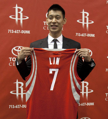 HOUSTON, TX - JULY 19: Jeremy Lin of the Houston Rockets displays his jersey during a press conference at Toyota Center on July 19, 2012 in Houston, Texas.  (Photo by Bob Levey/Getty Images)