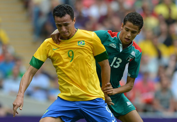 LONDON, ENGLAND - AUGUST 11:  Leandro Damiao of Brazil (front) battles for the ball with Diego Reyes of Mexico during the Men's Football Final between Brazil and Mexico on Day 15 of the London 2012 Olympic Games at Wembley Stadium on August 11, 2012 in Lo