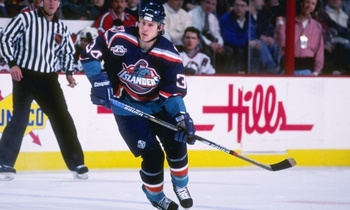 Photo found at http://blogs.thescore.com/nhl/2010/11/26/the-worst-blue-jerseys-in-nhl-history/