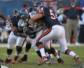 Urlacher and Briggs come together to make a tackle