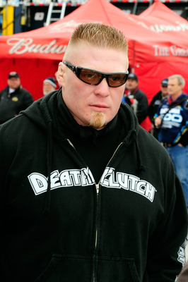 DAYTONA BEACH, FL - FEBRUARY 13:  MMA fighter Brock Lesnar walks in the garage area during practice for the Daytona 500 at Daytona International Speedway on February 13, 2010 in Daytona Beach, Florida.  (Photo by Sam Greenwood/Getty Images for NASCAR)