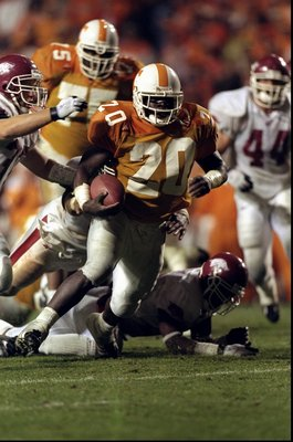 14 Nov 1998:  Travis Henry #20 of the Tennessee Volunteers runs with the ball during a game against the Arkansas Razorbacks at the Neyland Stadium in Knoxville, Tennessee. The Volunteers defeated the Razorbacks 28-24. Mandatory Credit: Tom Hauck  /Allspor