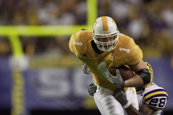 ATLANTA - DECEMBER 8:  Tight end Jason Witten #1 of the Tennessee Volunteers tries to break the tackle of safety Lionel Thomas #28 of the LSU Tigers during the Southeastern Conference Championship Game on December 8, 2001 at the Georgia Dome in Atlanta, G