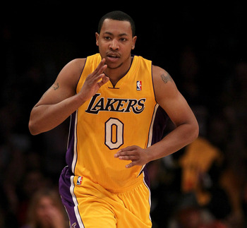 LOS ANGELES, CA - FEBRUARY 14:  Andrew Goudelock #0 of the Los Angeles Lakers celebrates after making a three point basket against the Atlanta Hawks at Staples Center on February 14, 2012 in Los Angeles, California.  The Lakers won 86-78.  NOTE TO USER: U