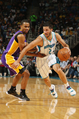 NEW ORLEANS, LA - APRIL 09:  Greivis Vasquez #21 of the New Orleans Hornets drives the ball around Ramon Sessions #7 of the Los Angeles Lakers at New Orleans Arena on April 9, 2012 in New Orleans, Louisiana.   NOTE TO USER: User expressly acknowledges and