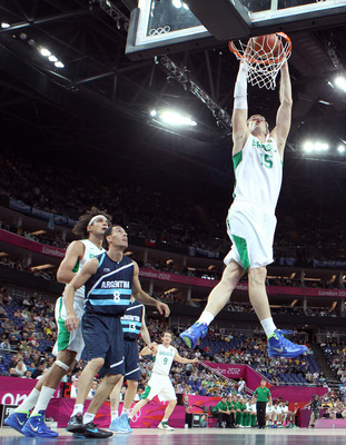 LONDON, ENGLAND - AUGUST 08:  Tiago Splitter #15 of Brazil dunks the ball in front of Pablo Prigioni #8 of Argentina in the first half during the Men's Basketball quaterfinal game on Day 12 of the London 2012 Olympic Games at North Greenwich Arena on Augu