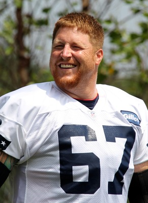 July 27, 2012; Foxborough, MA, USA; New England Patriots center Dan Koppen walks onto the field during the training camp at the team practice facility. Mandatory Credit: Stew Milne-US PRESSWIRE
