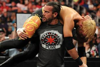 WWE Champion CM Punk delivers a GTS to Christian.