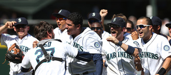 Felix Hernandez surrounded by his celebrating teammates.
