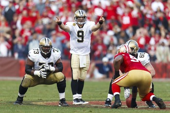 Jan 14, 2012; San Francisco, CA, USA; New Orleans Saints quarterback Drew Brees (9) calls an audible from behind the line of scrimmage against the San Francisco 49ers during the third quarter of the 2011 NFC divisional playoff game at Candlestick Park. Sa