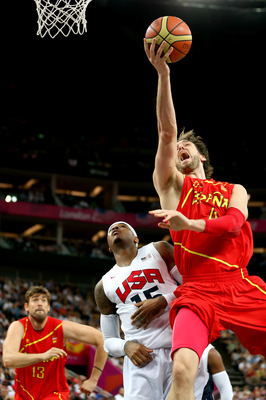 LONDON, ENGLAND - AUGUST 12:  Pau Gasol #4 of Spain drives for a shot attempt against Carmelo Anthony #15 of the United States during the Men's Basketball gold medal game on Day 16 of the London 2012 Olympics Games at North Greenwich Arena on August 12, 2
