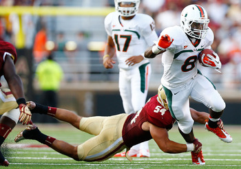 CHESTNUT HILL, MA - SEPTEMBER 01:  Duke Johnson #8 of the Miami Hurricanes runs through the arms of Nick Clancy #54 of the Boston College Eagles during the game on September 1, 2012 at Alumni Stadium in Chestnut Hill, Massachusetts.  (Photo by Jared Wicke