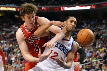 PHILADELPHIA, PA - MAY 10: Omer Asik #3 of the Chicago Bulls and Evan Turner #12 of the Philadelphia 76ers battle for the ball in Game Six of the Eastern Conference Quarterfinals in the 2012 NBA Playoffs at the Wells Fargo Center on May 10, 2012 in Philad