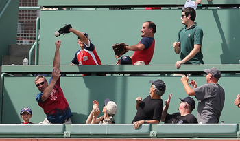 Red Sox fans go for a ball.  Not pictured:  Bandwagon riders, pink hats.