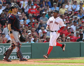 Carl Crawford scores a run against Minnesota on August 4.  Crawford has become the go-to case for people who think the Red Sox are overpaid.
