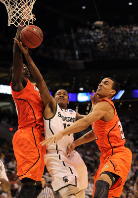Gorgui Dieng (left) with one of his season-high seven blocks against Michigan State in the 2012 Sweet Sixteen.