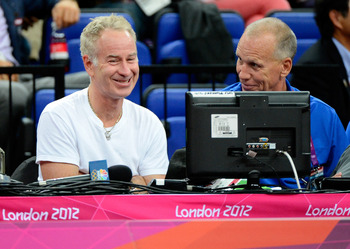 Doug Collins (right) alongside tennis great John McEnroe (left).