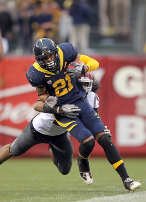 SAN FRANCISCO, CA - NOVEMBER 05:  Keenan Allen #21 of the California Golden Bears is tackled by Sekope Kaufusi #59 of the Washington State Cougars at AT&amp;T Park on November 5, 2011 in San Francisco, California.  (Photo by Ezra Shaw/Getty Images)