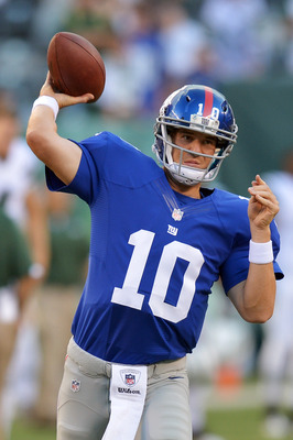 Eli Manning and the champion Giants handled the Jets.