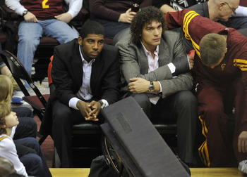 Feb 11, 2012; Cleveland, OH, USA; Cleveland Cavaliers point guard Kyrie Irving (left) and power forward Anderson Varejao sit on the bench with injuries in the fourth quarter against the Philadelphia 76ers at Quicken Loans Arena. Mandatory Credit: David Ri