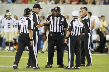 CANTON, OH - AUGUST 5: Game officials discuss the running of a play during the second half of the Pro Football Hall of Fame game at Fawcett Stadium on August 5, 2012 in Canton, Ohio. The Saints defeated the Cardinals 17-10. (Photo by Jason Miller/Getty Im