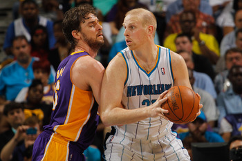 NEW ORLEANS, LA - MARCH 14:  Chris Kaman #35 of the New Orleans Hornets looks to drive the ball around Pau Gasol #16 of the Los Angeles Lakers at the New Orleans Arena on March 14, 2012 in New Orleans, Louisiana.  NOTE TO USER: User expressly acknowledges