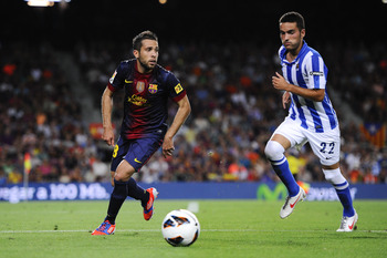 BARCELONA, SPAIN - AUGUST 19:  Jordi Alba of FC Barcelona (L) duels for the ball with Daniel Estrada Agirrezabalaga of Real Sociedad during the La Liga match between FC Barcelona and Real Sociedad de Futbol at Camp Nou on August 19, 2012 in Barcelona, Spa