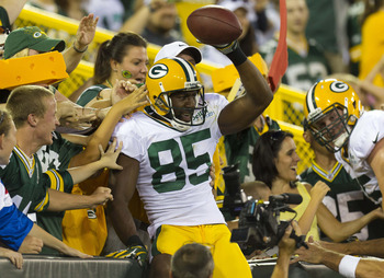 August 3, 2012; Green Bay, WI, USA; Green Bay Packers wide receiver Greg Jennings (85) celebrates a touchdown catch by doing the