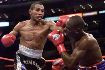 """Six Heads"" Lewis seen here getting battered by Ricardo Mayorga."