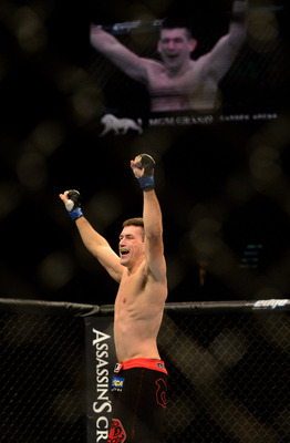 Jul. 7, 2012; Las Vegas, NV, USA; UFC fighter Demian Maia (left) celebrates his win over Dong Hyun Kim during a welterweigh bout in UFC 148 at the MGM Grand Garden Arena. Mandatory Credit: Mark J. Rebilas-US PRESSWIRE