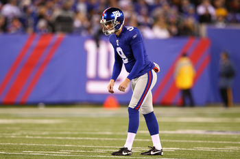 EAST RUTHERFORD, NJ - DECEMBER 04:  Lawrence Tynes #9 of the New York Giants gets set to kick the ball against the Green Bay Packers at MetLife Stadium on December 4, 2011 in East Rutherford, New Jersey.  (Photo by Al Bello/Getty Images)