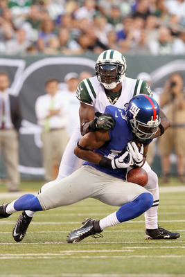 August 18, 2012; East Rutherford, NJ, USA; New York Jets cornerback Antonio Cromartie (31) breaks up a pass intended for New York Giants wide receiver Ramses Barden (13) during the first quarter of a preseason game at MetLife Stadium. Mandatory Credit: Br