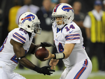 MINNEAPOLIS, MN - AUGUST 17: Ryan Fitzpatrick #14 of the Buffalo Bills hands the ball to C.J. Spiller #28 during the first quarter against the Minnesota Vikings on August 17, 2012 at Mall of America Field at the Hubert H. Humphrey Metrodome in Minneapolis