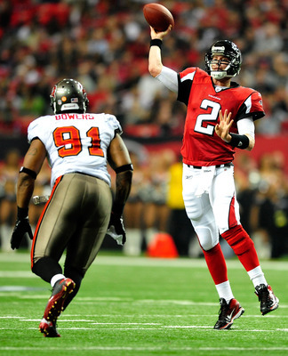 ATLANTA, GA - JANUARY 01: Matt Ryan #2 of the Atlanta Falcons throws over defender Da'Quan Bowers #91 of the Tampa Bay Buccaneers during play at the Georgia Dome on January 1, 2012 in Atlanta, Georgia. The Falcons won 45-24. (Photo by Grant Halverson/Gett