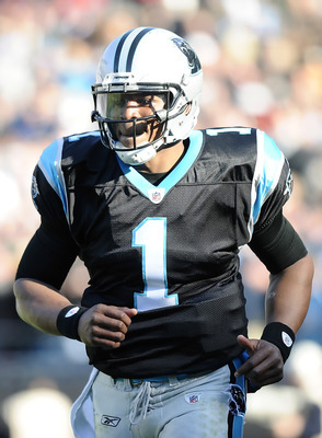 CHARLOTTE, NC - DECEMBER 11:  Quarterback Cam Newton #1 of the Carolina Panthers runs off the field after a touchdown during the game against the Atlanta Falcons at Bank of America Stadium on December 11, 2011 in Charlotte, North Carolina.  (Photo by Jare