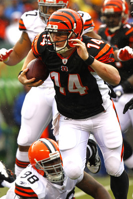 CINCINNATI, OH - NOVEMBER 27:  Andy Dalton #14 of the Cincinnati Bengals runs the ball during a play against the Cleveland Browns at Paul Brown Stadium on November 27, 2011 in Cincinnati, Ohio.  (Photo by Tyler Barrick/Getty Images)