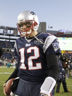 FOXBORO, MA - DECEMBER 24:  Tom Brady #12 of the New England Patriots walks off the field after New England's 27-24 win over the Miami Dolphins at Gillette Stadium on December 24, 2011 in Foxboro, Massachusetts.  (Photo by Winslow Townson/Getty Images)
