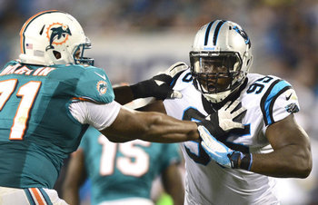 Panthers defensive end Charles Johnson terrorized Jonathan Martin on Friday night (Photo courtesy MiamiHerald.com)