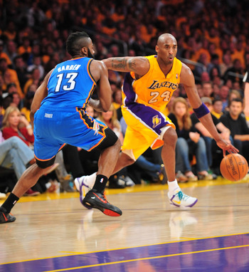 Kobe Brant drives past James Harden