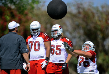Nate Potter (76) throws balls at camp.