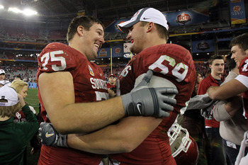 Evans (left) with former Sooner Eric Mensik
