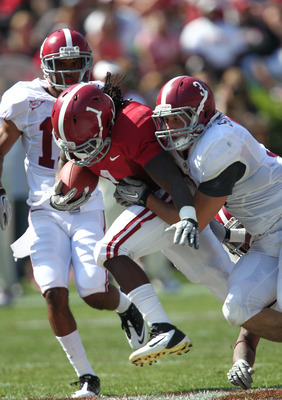 April 14, 2012; Tuscaloosa, AL, USA;  Alabama Crimson Tide running back Dee Hart (1) is tackled by  defensive back Vinnie Sunseri (3)  at Bryant Denny Stadium. Mandatory Credit: Marvin Gentry-US PRESSWIRE