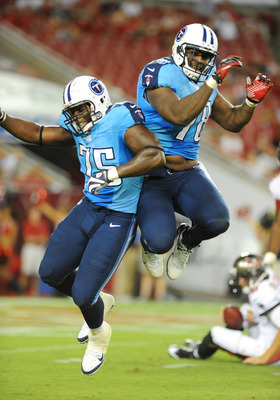 TAMPA, FL - AUGUST 17:  Defensive back Keyunta Dawson #75 and defensive end Leger Douzable #78 of the Tennessee Titans celebrate a sack against the Tampa Bay Buccaneers in an NFL preseason game August 17, 2012 at Raymond James Stadium in Tampa, Florida. (